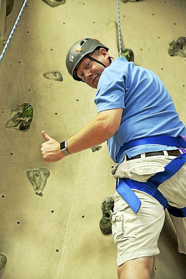 Northwestern Connecticut Community College president Michael A. Rooke will tap into his adventurous side when he rappels 111 feet down the side of Torrington Towers on Saturday, September 16, 2017. Photo: Contributed Photo