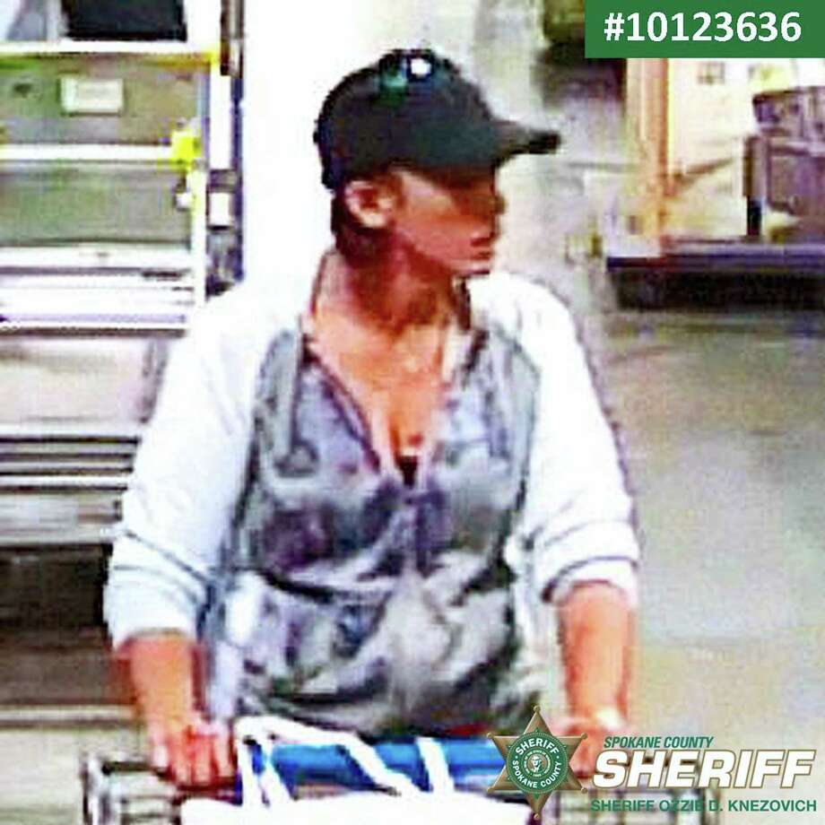 An undated security video image released by The Spokane County Sheriff's Office shows a person of interest in the theft of a purse of a parent who rushed to check on her child following the school shooting  at Freeman High School in Rockford, Wash.  Authorities say the purse was stolen Wednesday, Sept. 13, 2017, as parents converged on Freeman High School, where a gunman had opened fire, killing one student and injuring three others. Photo: Spokane County Sheriff's Office Via AP   / Spokane County Sheriff's Office