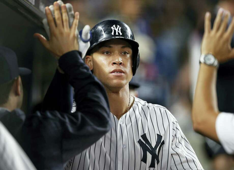 The Yankees' Aaron Judge is congratulated after his sixth-inning home run. Photo: Rich Schultz — The Associated Press  / FR27227 AP