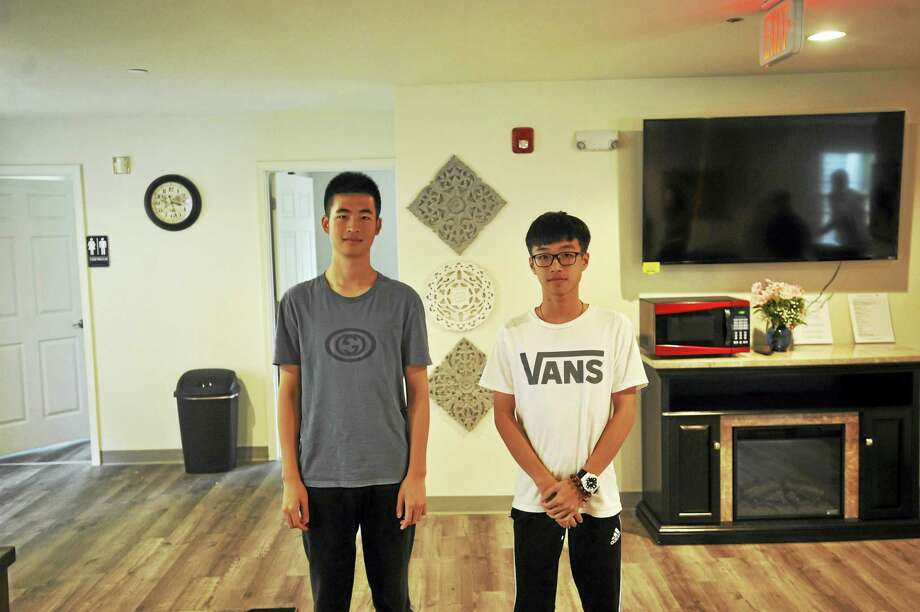International students including Hillson Liu and Gavin Pang are settling into a new dormitory at The Gilbert School ahead of the new year., Photo: Ben Lambert / Hearst Connecticut Media
