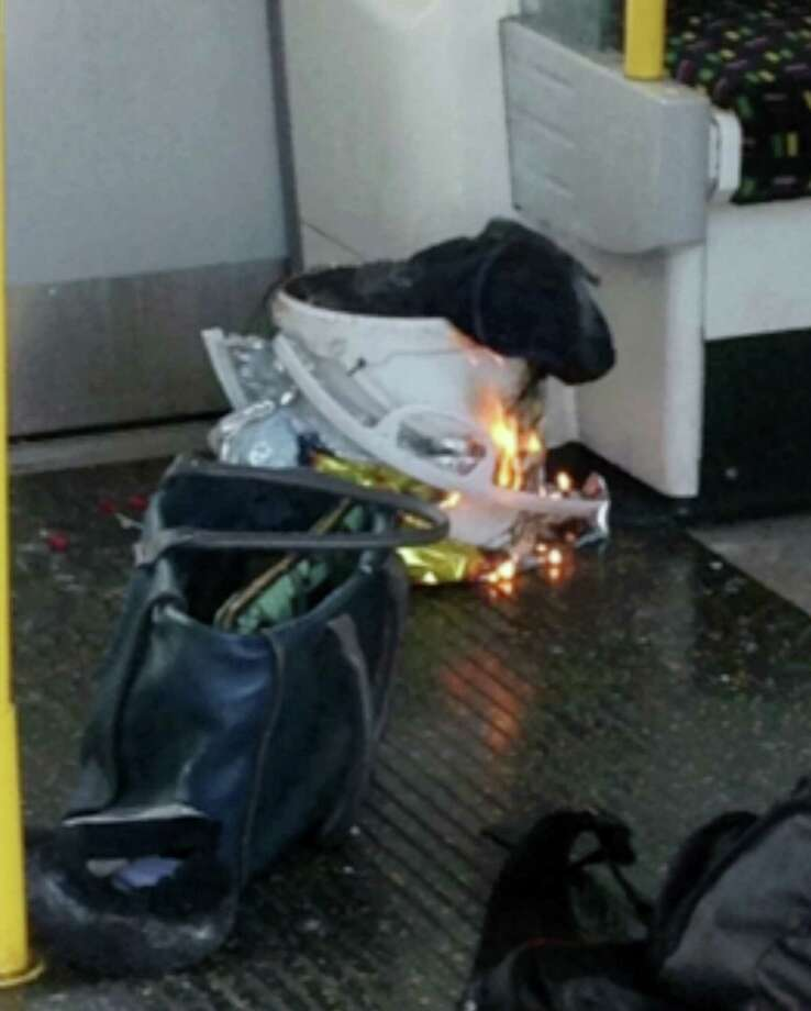 """In this image made from video, fire ignites at a southwest London subway station on Friday, Sept. 15, 2017. London's Metropolitan Police and ambulance services were confirming they were at the scene of """"an incident"""" at the Parsons Green subway station in the southwest of the capital. The underground operator said services were cut along the line. Photo: @RRIGS Via AP  / @RRIGS"""