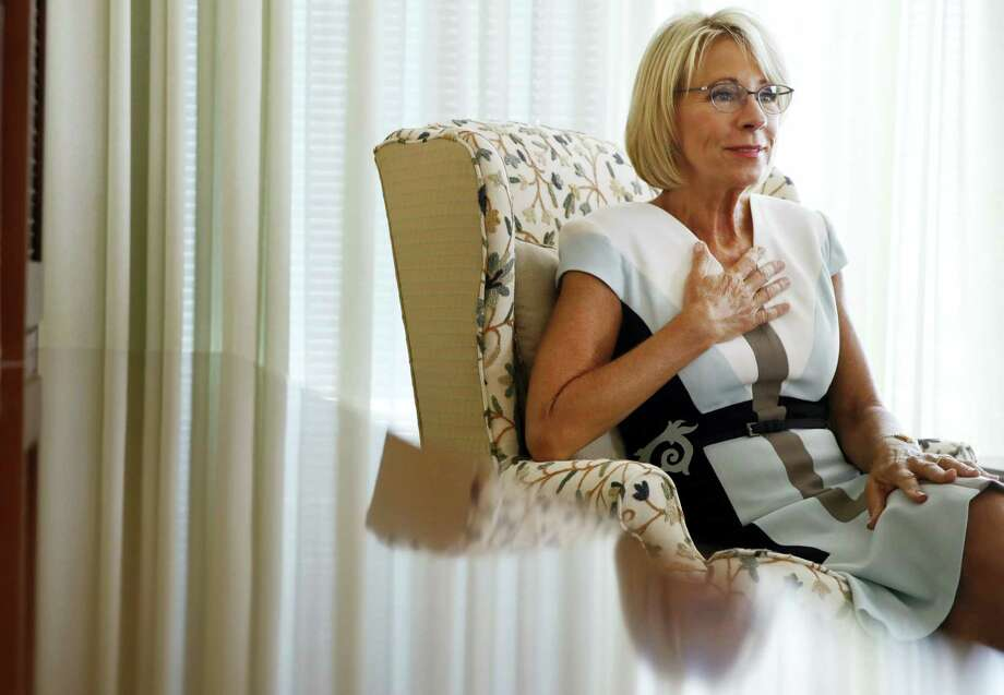 """Education Secretary Betsy DeVos is interviewed in her office at the Education Department in Washington, Wednesday, Aug. 9, 2017. DeVos is distancing herself from earlier comments about the nation's historically black colleges and universities being pioneers of school choice. In an interview with the Associated Press, she has acknowledged that in the past """"racism was rampant and there were no choices"""" for African-Americans in higher education. Photo: Jacquelyn Martin / AP Photo  / Copyright 2017 The Associated Press. All rights reserved."""