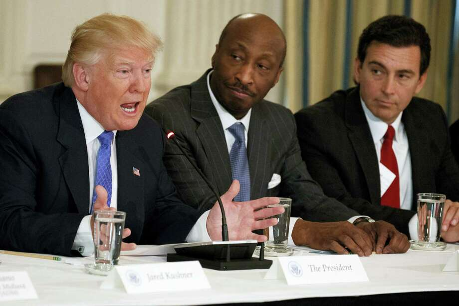 "In this Feb. 23, 2017 photo, President Donald Trump, left, speaks during a meeting with manufacturing executives at the White House in Washington, including Merck CEO Kenneth Frazier, center, and Ford CEO Mark Fields. Frazier is resigning from the President's American Manufacturing Council citing ""a responsibility to take a stand against intolerance and extremism."" Frazier's resignation comes shortly after a violent confrontation between white supremacists and protesters in Charlottesville, Va. Photo: AP Photo — Evan Vucci, File  / Copyright 2017 The Associated Press. All rights reserved."
