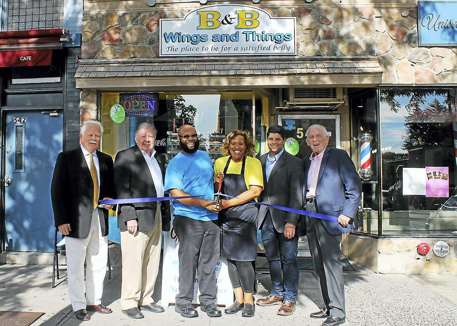 B&B Wings and Things held a grand opening on 540 Main St., Middletown, Sept. 1. From left are Middletown Small Business Development Counselor Paul Dodge, Chamber Vice Chairman Jay Polke, co-owners of B&B Wings and Things Marc Barham and Rita Barham, Middletown Mayor Dan Drew and Chamber President Larry McHugh. Photo: Courtesy Middlesex County Chamber Of Commerce