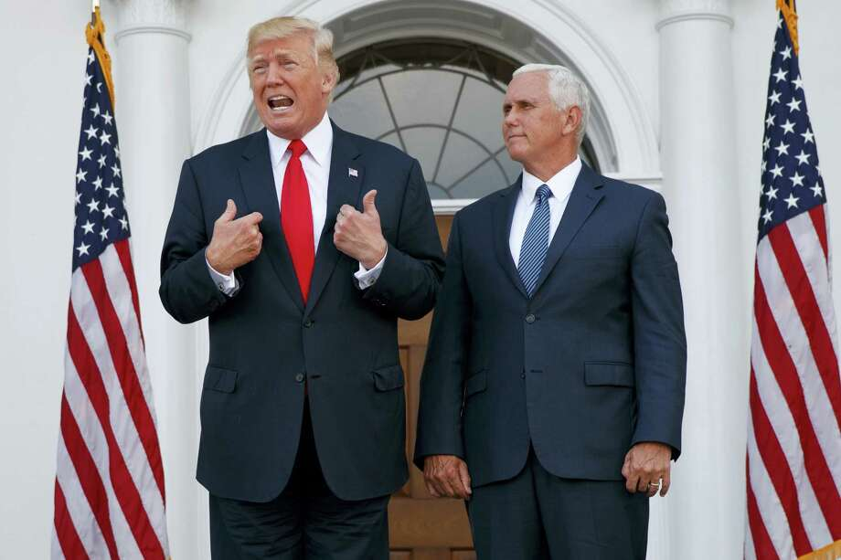 """In this Aug. 10, 2017, photo, President Donald Trump, accompanied by Vice President Mike Pence, speaks to reporters before a security briefing at Trump National Golf Club in Bedminster, N.J. Pence departs Sunday for Latin America, a trip that comes on the heels of yet another provocative statement fromTrump that Pence is sure to have to answer for: this time Trump's sudden declaration that he would not rule out a """"military option"""" in Venezuela, where president Nicolas Maduro has been consolidating power, plunging the country into chaos. Photo: AP Photo — Evan Vucci  / Copyright 2017 The Associated Press. All rights reserved."""
