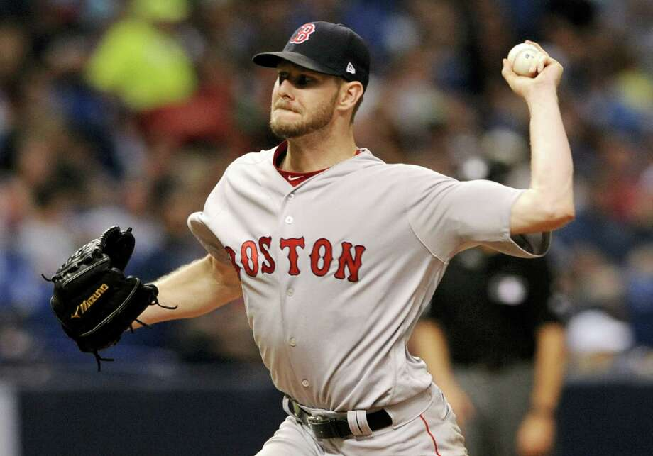 Boston Red Sox starter Chris Sale pitches against the Tampa Bay Rays during the sixth inning. The Red Sox won 2-0. Photo: STEVE NESIUS — THE ASSOCIATED PRESS  / FR69810 AP
