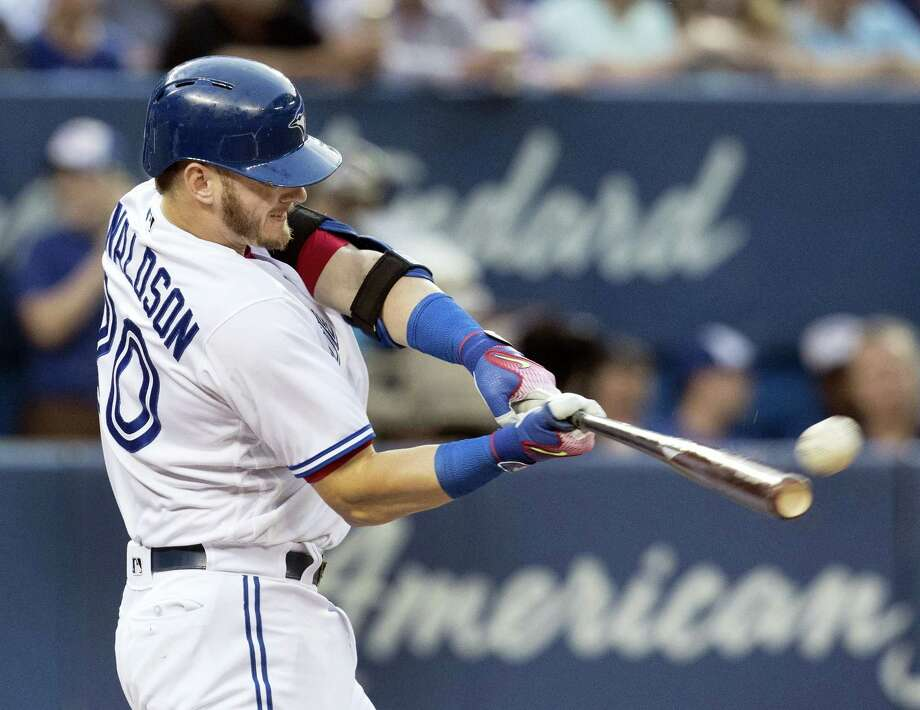 Toronto's Josh Donaldson hits a two-run home run against the New York Yankees during the third inning of their baseball game in Toronto on Tuesday. Donaldson homered twice as the Blue Jays won 4-2. Photo: Fred Thornhill/The Canadian Press Via AP  / The Canadian Press