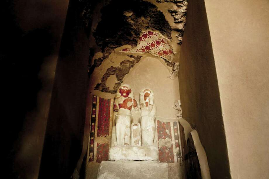 Statues at the entrance of the New Kingdom tomb that belongs to a royal goldsmith in a burial shaft during a press conference on site, in Luxor, Egypt, Saturday, Sept. 9, 2017. El-Anany said the tomb is not in good condition, but it contains a statue of the goldsmith and his wife as well as a funerary mask. He said a shaft in the tomb contained mummies belonging to ancient Egyptian people who lived during the 21st and 22nd dynasties. Photo: AP Photo/Nariman El-Mofty   / Copyright 2017 The Associated Press. All rights reserved.