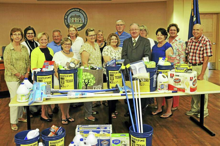Torrington municipal employees recently donated a quantity of cleaning supplies and money to help victims of recent hurricanes in Texas and Florida Thursday. Photo: Ben Lambert / Hearst Connecticut Media
