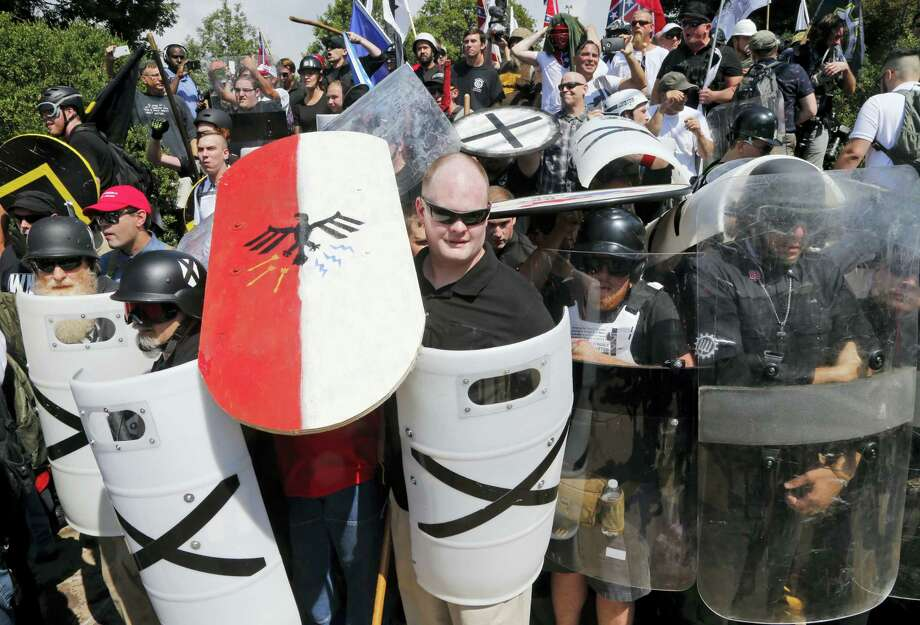 White nationalist demonstrators use shields as they guard the entrance to Lee Park in Charlottesville, Va. on Aug. 12, 2017. Photo: AP Photo — Steve Helber  / Copyright 2017 The Associated Press. All rights reserved.