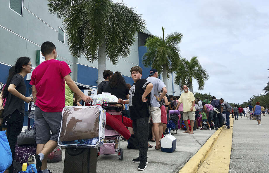 Thousands of people wait in line to get into a Hurricane Irma shelter at the Germain Arena in Estero, Fla., on Saturday, Sept. 9, 2017. Photo: AP Photo/Jay Reeves   / Copyright 2017 The Associated Press. All rights reserved.