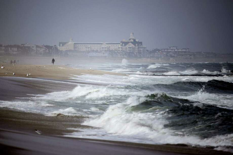 A beachgoer walks along the water as waves crash in Manasquan, N.J., Thursday, Sept. 14, 2017. Swells are up from recent hurricanes in the Atlantic Ocean, including Hurricane Jose, which is expected to stay out to sea, according to meteorologists. Photo: Julio Cortez / AP Photo  / Copyright 2017 The Associated Press. All rights reserved.