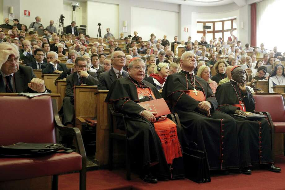 From left, former Chairman of the Vatican Bank Ettore Gotti Tedeschi, Cardinals Raymond Leo Burke, Gerhard Ludwig Mueller, and Robert Sarah attend a conference on the Latin Mass at the Pontifical University of St. Thomas Aquinas in Rome, Thursday, Sept. 14, 2017. Photo: AP Photo/Gregorio Borgia   / Copyright 2017 The Associated Press. All rights reserved.