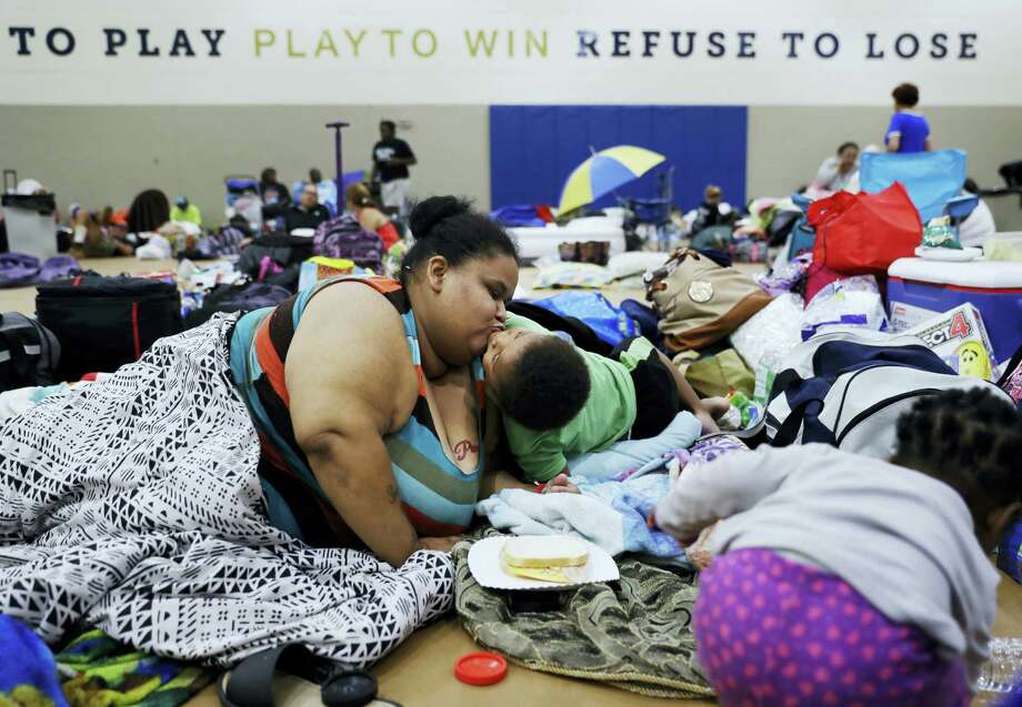 Annette Davis kisses her son Darius, 3, while staying at a shelter in Miami after evacuating from their home in Florida City, Fla., ahead of Hurricane Irma. Photo: David Goldman / Ap File Photo / Copyright 2017 The Associated Press. All rights reserved.