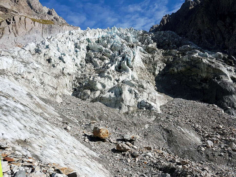 In this photo taken on Thursday, Aug. 24, 2017, the area where corpses were spotted on Mont Blanc's Southern face. The corpses were spotted on Wednesday on the Mirage glacier by an alpinist. Italian mountain rescue crews say they have recovered the remains of two, or possibly three, hikers on a glacier on Mont Blanc's southern face, likely dating from the 1980s or 1990s. Alpine rescue commander Delfino Viglione said Friday the bodies were discovered this week by a hiker who was searching the area for artifacts from decades-old plane crashes, including one in the 1960s that killed more than 100 people. Photo: Italian Firefighters Via AP   / ANSA