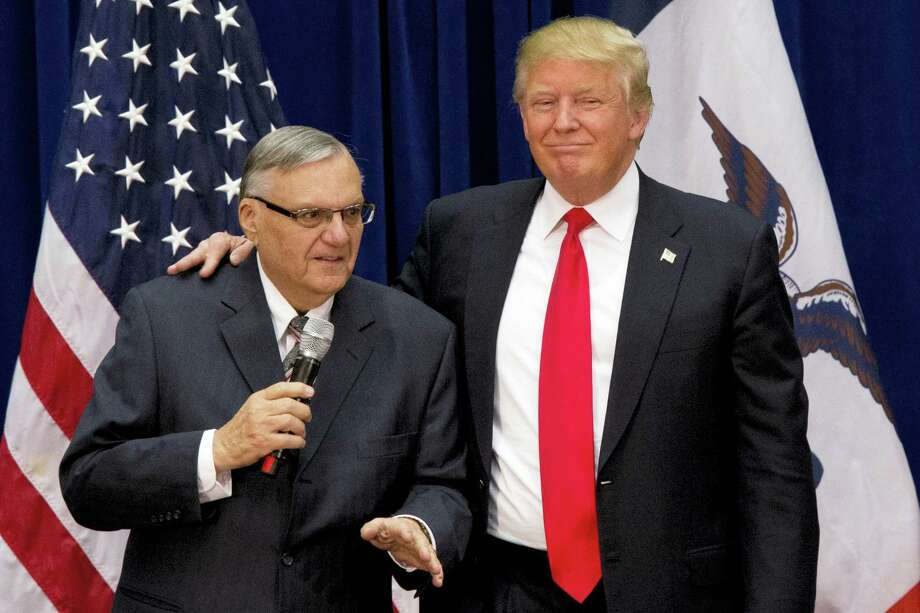 """In this Jan. 26, 2016 file photo, then-Republican presidential candidate Donald Trump is joined by Joe Arpaio, the sheriff of metro Phoenix, at a campaign event in Marshalltown, Iowa. President Donald Trump has pardoned former sheriff Joe Arpaio following his conviction for intentionally disobeying a judge's order in an immigration case. The White House announced the move Friday night, Aug. 25, 2017, saying the 85-year-old ex-sheriff of Arizona's Maricopa County was a """"worthy candidate"""" for a presidential pardon. Photo: AP Photo/Mary Altaffer, File  / Copyright 2017 The Associated Press. All rights reserved."""