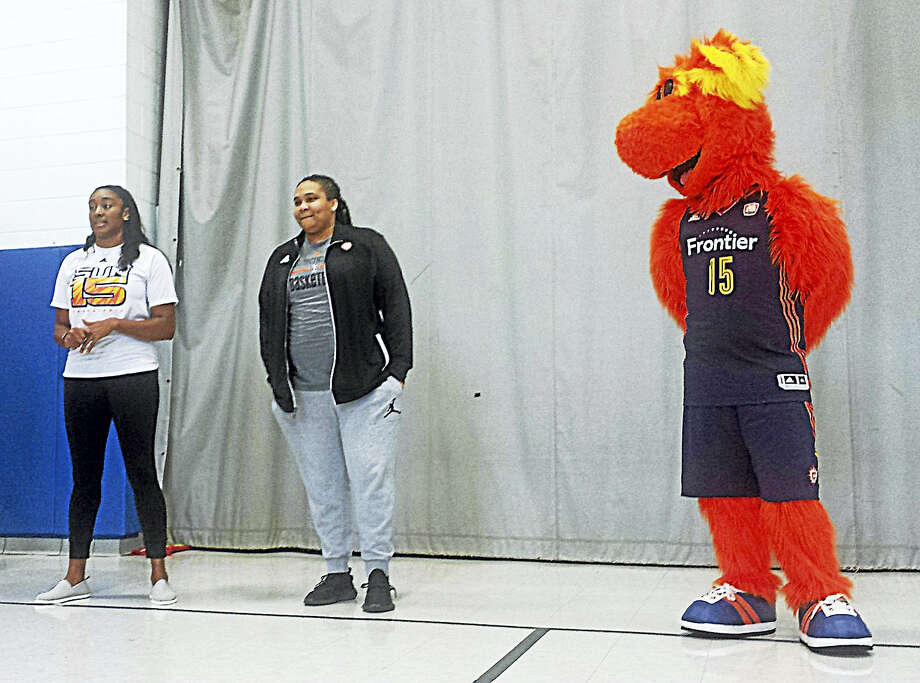 Sun players Danielle Adams, Morgan Tuck and Blaze took part in the assembly Thursday morning in Middletown. Photo: Cassandra Day / Hearst Connecticut Media
