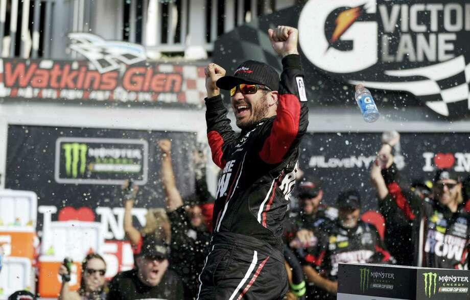 Martin Truex Jr. celebrates after winning Sunday in Watkins Glen, N.Y. Photo: Matt Slocum — The Associated Press  / Copyright 2017 The Associated Press. All rights reserved.