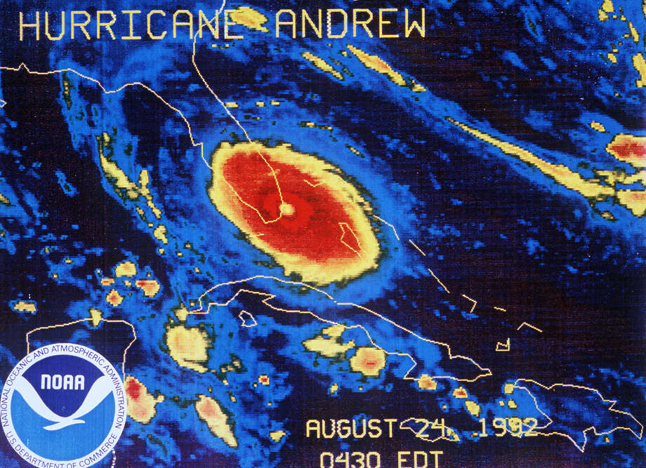 This Aug. 24, 1992 file image provided by NOAA shows a NOAA GOES-7 thermal infrared geostationary satellite image of Hurricane Andrew approaching landfall south of Miami. For an entire generation in South Florida, Hurricane Andrew was the monster storm that reshaped a region. Irma is likely to blow that out of the water. Bigger and with a 90-degree different path of potential destruction, Irma is forecast to hit lots more people and buildings than 1992's Andrew, said experts, including veterans of Andrew. Photo: NOAA Via AP, File  / 1992 AP