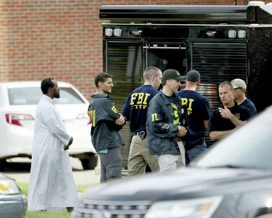 Law enforcement officials investigate an explosion at the Dar Al-Farooq Islamic Center in Bloomington, Minn., on Aug. 5, 2017. Bloomington police Chief Jeff Potts said Saturday that investigators are trying to determine the cause of the blast. Authorities say the explosion damaged one room but it didn't hurt anyone. (David Joles/Star Tribune via AP) Photo: AP / Star Tribune