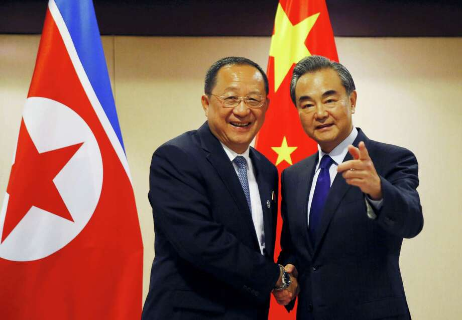 North Korean Foreign Minister Ri Yong Ho, left, is greeted by his Chinese counterpart Wang Yi prior to their bilateral meeting in the sidelines of the 50th ASEAN Foreign Ministers' Meeting and its Dialogue Partners on Aug. 6, 2017 in suburban Pasay city, south Manila, Philippines. Bolstered by new U.N. sanctions, the United States and North Korea's neighbors are joining in a fresh attempt to isolate Pyongyang over its nuclear and missile programs, in a global campaign cheered on by U.S. President Donald Trump. Photo: AP Photo — Bullit Marquez  / Copyright 2017 The Associated Press. All rights reserved.