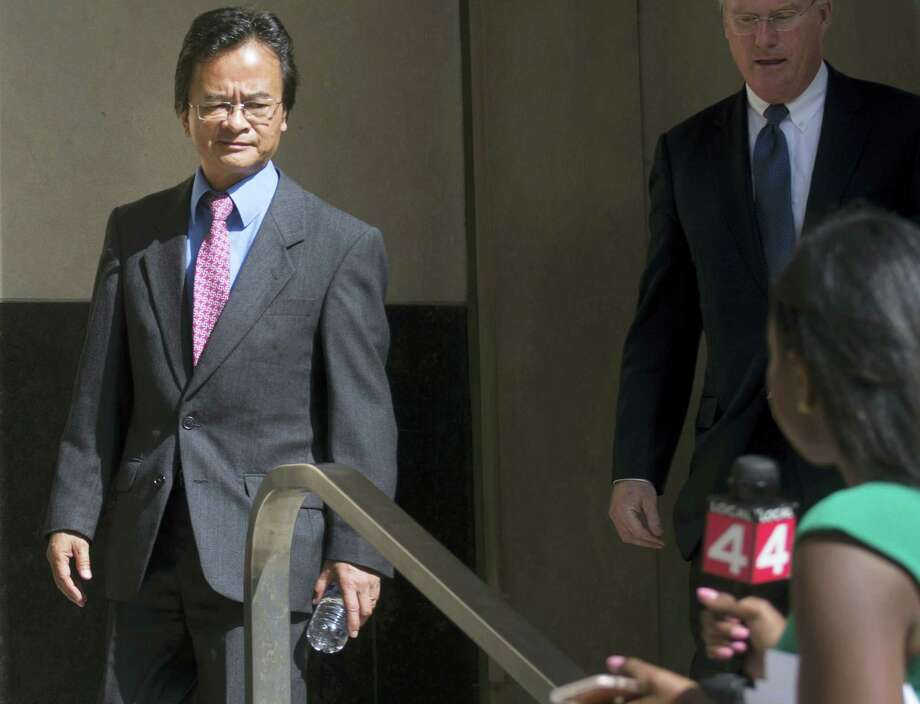 In this Sept. 9, 2016, file photo, Volkswagen engineer James Robert Liang, left, leaves court, in Detroit, after pleading guilty to one count of conspiracy in the company's emissions cheating scandal. U.S. prosecutors are seeking a three-year prison sentence for a Volkswagen engineer who had a key role in the company's diesel emissions scandal. Liang is scheduled to be sentenced Friday, Aug. 25, 2017, in Detroit federal court. He is one of two VW employees to plead guilty, although others charged in the case are in Germany and out of reach. Photo: Virginia Lozano/Detroit News Via AP, File  / Detroit News