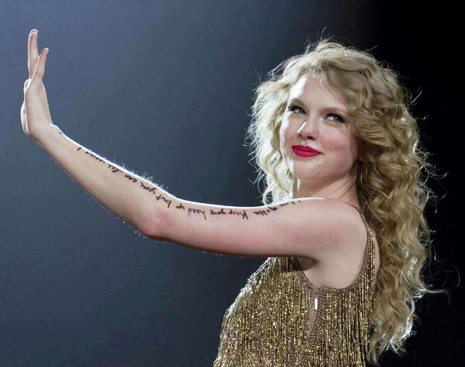 """In this May 27, 2011 photo, singer Taylor Swift performs her song """"Story of Us"""", as she kicks off her Speak Now North American tour in Omaha, Neb. David Mueller, a former radio host, claims in a lawsuit that he lost his job because Swift falsely accused him of groping her. Swift has countersued, alleging she's the victim of sexual assault. Mueller is seeking up to $3 million in damages at the trial that begins Monday, Aug. 7, 2017, in federal court in Denver. Both sides say no settlement is in the works. Photo: AP Photo — Nati Harnik, File"""