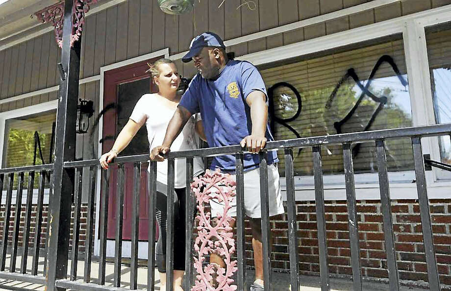 David and Senka Thompson, of Sherman, found racial slurs spray-painted on the front of their new restaurant, Thompson's, at 300 Kent Road in New Milford on Wednesday. Photo: Carol Kaliff / Hearst Connecticut Media