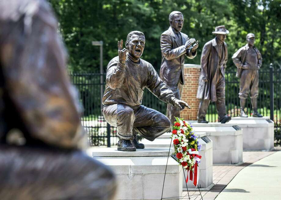 A wreath is displayed in front of a statue of Ara Parseghian, part of Miami University's Cradle of Coaches, Wednesday in Oxford, Ohio. Parseghian died Wednesday. He was 94. Photo: Nick Graham — The Journal-News Via AP  / The Journal-News