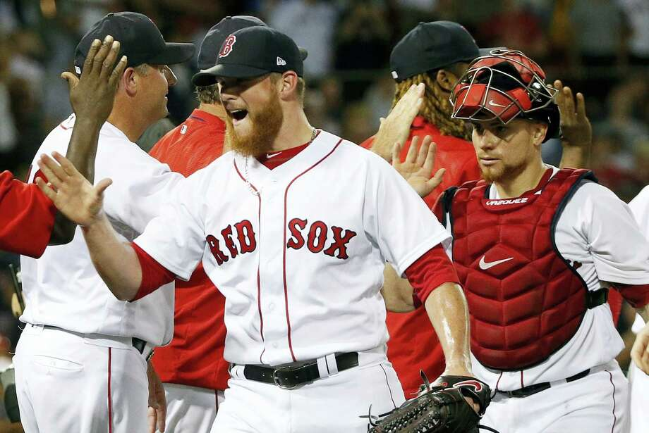 Red Sox closer Craig Kimbrel, left, and Christian Vazquez, right, celebrate after Saturday's win over the White Sox. Photo: Michael Dwyer — The Associated Press  / AP2017