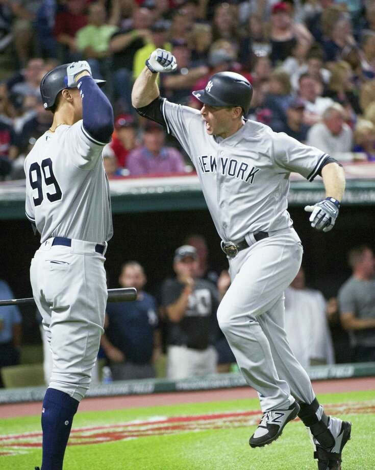 The Yankees' Chase Headley, right, celebrates after hitting a solo home run on Saturday. Photo: Phil Long — The Associated Press  / FR53611 AP
