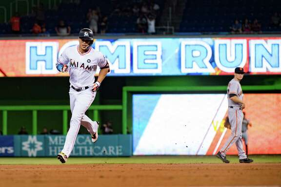 MIAMI, FL - AUGUST 14: Giancarlo Stanton #27 of the Miami Marlins hits his record breaking 43rd homerun of the season during the game between the Miami Marlins and the San Francisco Giants at Marlins Park on August 14, 2017 in Miami, Florida. (Photo by Mark Brown/Getty Images)