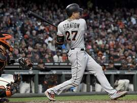 Miami's Giancarlo Stanton doubles in a game at AT&T Park in July. Could the Giants get him to play there for them?