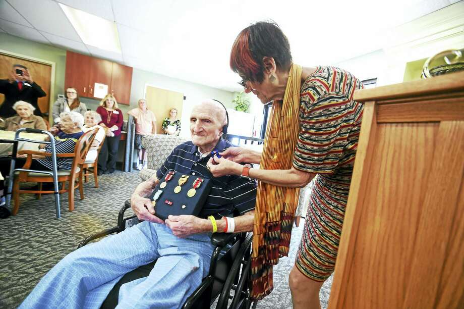 U.S. Rep. Rosa DeLauro pins a Connecticut Wartime Service Medal on Jake Greenberg for his service during World War II, at the Mary Wade Home in New Haven Friday. Photo: Arnold Gold / Hearst Connecticut Media  / New Haven Register