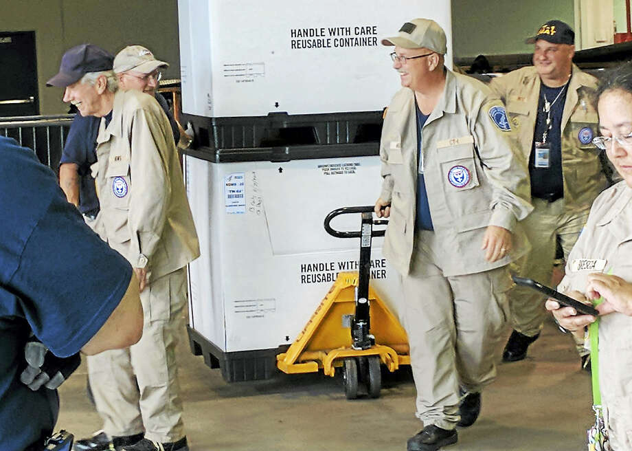 Middletown's Westfield Fire District Deputy Fire Marshal Harold Holmes moves a pallet of supplies in Houston, Texas, at the NRG Center in preparation for his team leaving Rosenberg, Texas. Holmes was deployed for 10 days to help hurricane Harvey victims with medical issues at the temporary hospital his crew set up in the city, which is located an hour's drive from Houston. Photo: Courtesy Harold Holmes