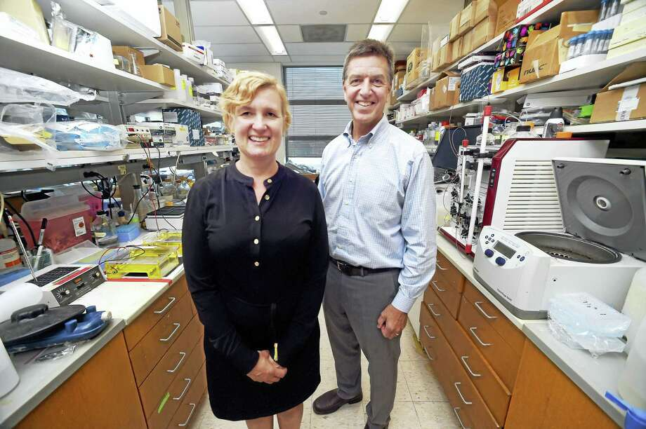 Erika R. Smith, CEO of ReNetX Bio Inc., is photographed with Dr. Stephen M. Strittmatter, founder of the company, in his lab at the Boyer Center for Molecular Medicine in New Haven. Photo: Arnold Gold / Hearst Connecticut Media  / New Haven Register