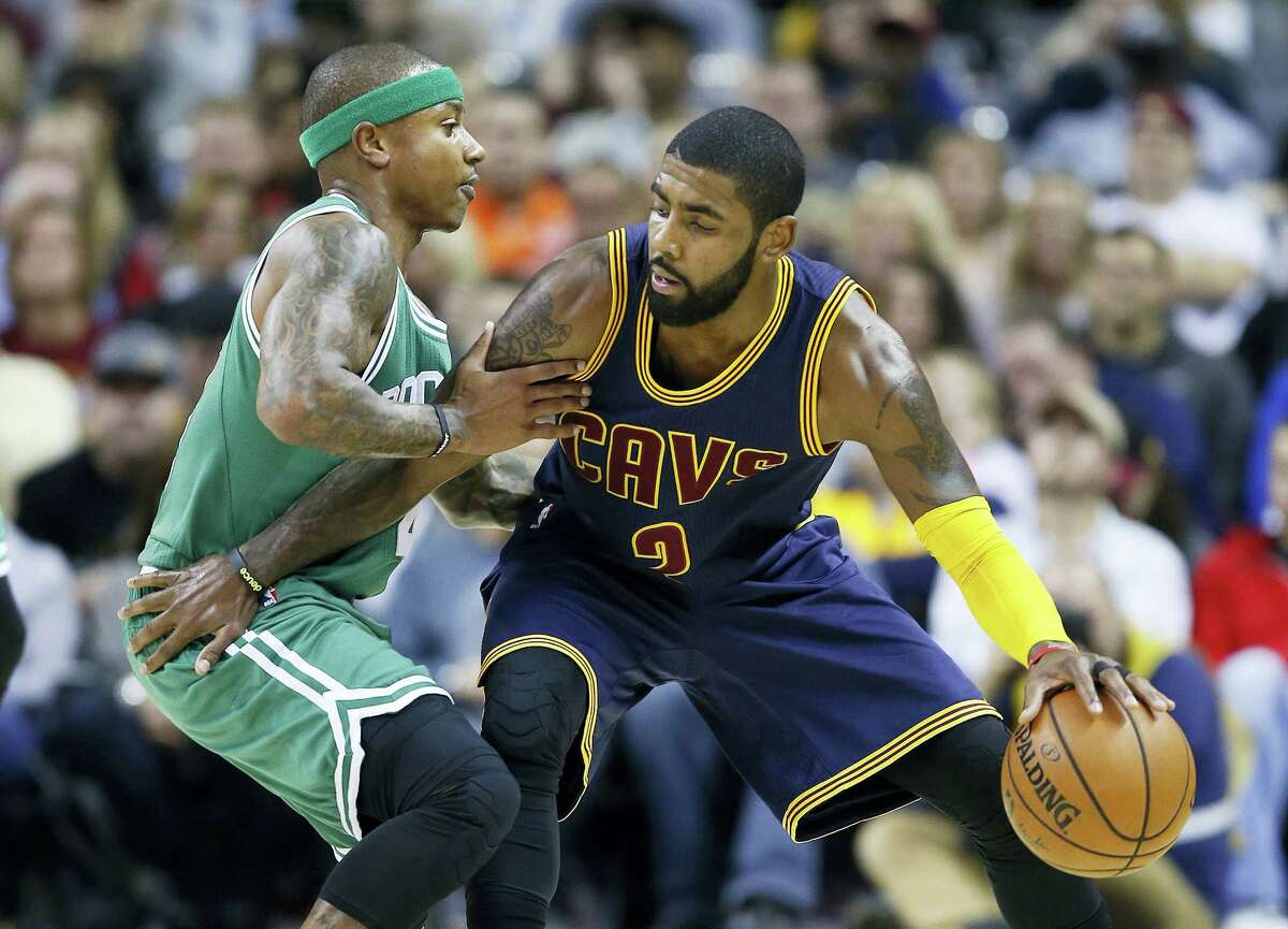 In this Nov. 3, 2016 photo, Cleveland Cavaliers' Kyrie Irving, right, looks to drive against Boston Celtics' Isaiah Thomas during the first half of an NBA basketball game in Cleveland. Irving, who asked Cavaliers owner Dan Gilbert to trade him earlier this summer, could be on his way to Boston as the Cavaliers are in serious negotiations with the Celtics about swapping him for point guard Thomas. Since Irving made his stunning request, the defending Eastern Conference champions have been looking for a trade partner. They may have found the perfect one and could be nearing a deal with the Celtics, said the person who spoke Tuesday night, Aug. 22, 2017, to The Associated Press on condition of anonymity because of the sensitivity of the talks.