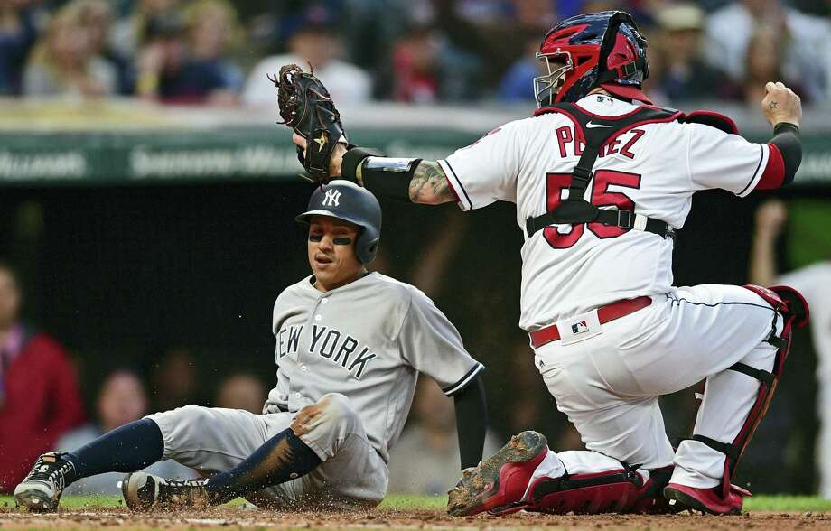 Indians catcher Roberto Perez, right, tags out the Yankees' Ronald Torreyes in the fifth inning on Friday. Photo: David Dermer — The Associated Press  / AP 2017