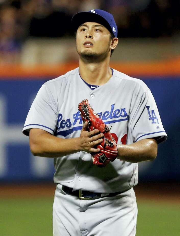 Dodgers starting pitcher Yu Darvish walks off the field at the end of the seventh inning on Friday. Photo: Julie Jacobson — The Associated Press  / Copyright 2017 The Associated Press. All rights reserved.