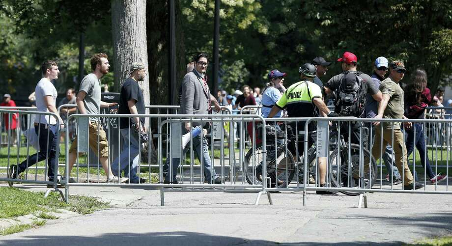 """Organizers depart a """"Free Speech"""" rally staged by conservative activists on Boston Common, Saturday, Aug. 19, 2017, in Boston.  One of the planned speakers of a conservative activist rally that appeared to end shortly after it began says the event """"fell apart."""" Dozens of rallygoers gathered Saturday on Boston Common, but then left less than an hour after the event was getting underway. Thousands of counterprotesters had also gathered. Photo: Michael Dwyer / AP Photo  / Copyright 2017 The Associated Press. All rights reserved."""