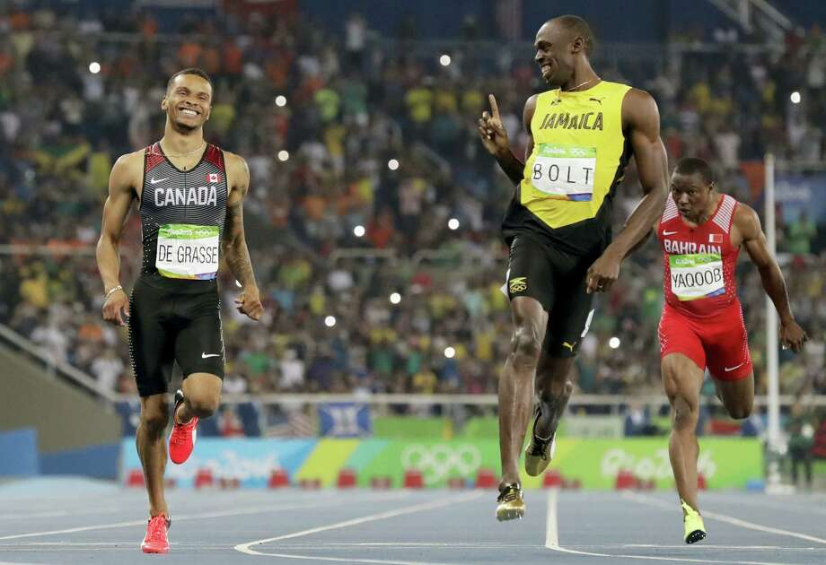 FILE - In this Aug. 17, 2016, file photo, Jamaica's Usain Bolt, right, gestures towards Canada's Andre De Grasse after the finish of the men's 200-meter semifinal during the athletics competitions of the 2016 Summer Olympics at the Olympic stadium in Rio de Janeiro, Brazil. Hardly a week goes by without someone mentioning Usain Bolt and his playful finger wag toward the Canadian sprinter at the Olympics. It was a point of pride for Andre De Grasse _ the Jamaican great acknowledging his presence. Even more to the point: It was a potential sign of things to come. (AP Photo/David J. Phillip, File) Photo: AP / Copyright 2016 The Associated Press. All rights reserved.