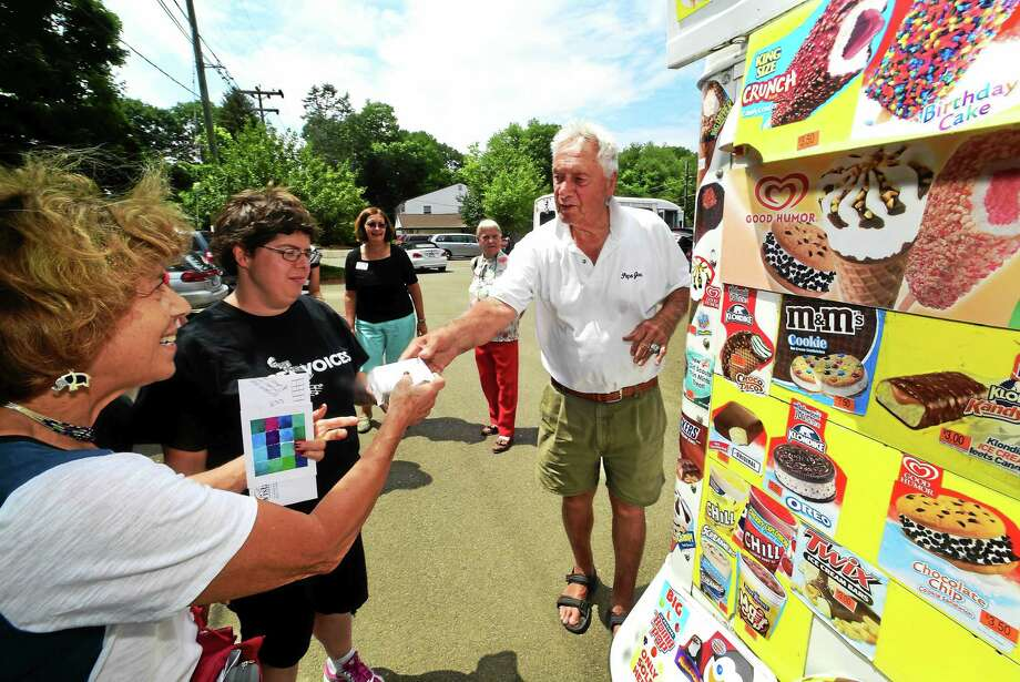 "(Peter Hvizdak - New Haven Register) Good Humor man Joseph ""Papa Joe"" Barbato of Madison gives his customers their ice cream at a party stop in Madison Tuesday afternoon July 14, 2015. Photo: ©2015 Peter Hvizdak / ©2015 Peter Hvizdak"