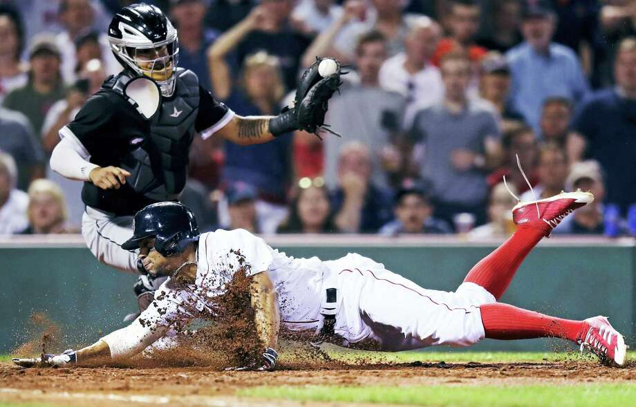 Boston's Xander Bogaerts slides as he beats the tag by Chicago White Sox catcher Omar Narvaez to score on a double by Mitch Moreland during the sixth inning of the Red Sox 9-5 victory. Photo: CHARLES KRUPA — THE ASSOCIATED PRESS  / Copyright 2017 The Associated Press. All rights reserved.