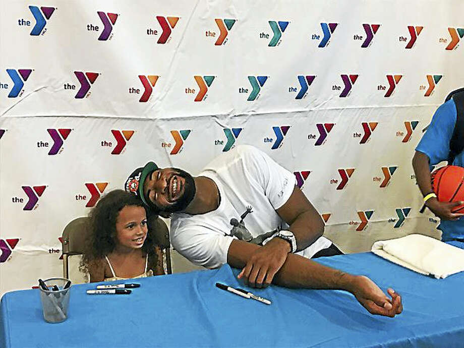 Andre Drummond jokes around with a young fan while signing autographs at Middlesex YMCA in Middletown on Friday. Photo: David Borges/Hearst Connecticut Media