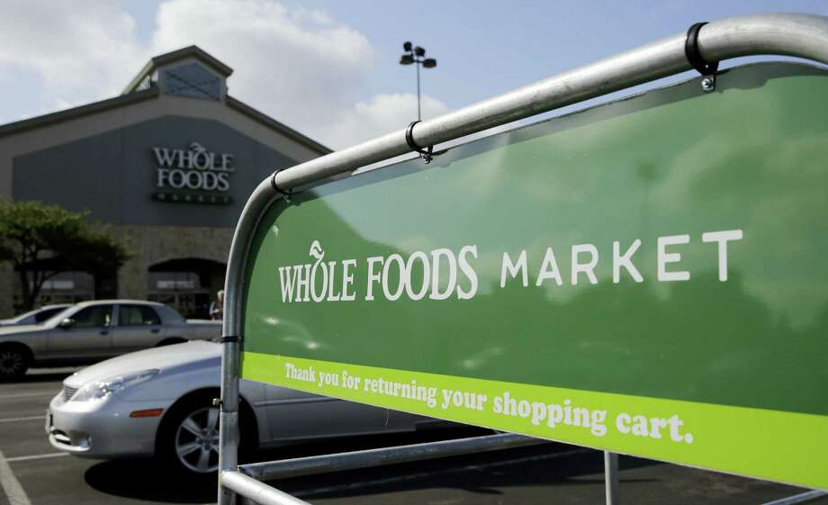 """This Friday, June 16, 2017, photo shows a Whole Foods Market in San Antonio. Whole Foods shareholders voted Wednesday, Aug. 23, 2017, to bless a $13.7 billion union with Amazon that the organic grocery chain's CEO had called """"love at first sight."""" By buying Whole Foods, Amazon will get more than 460 stores and potentially very lucrative data about how shoppers behave offline. Photo: Eric Gay / AP Photo  / Copyright 2017 The Associated Press. All rights reserved."""