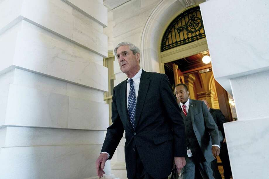 In this June 21, 2017, file photo, former FBI Director Robert Mueller, the special counsel probing Russian interference in the 2016 election, departs Capitol Hill following a closed door meeting in Washington. Mueller is using a grand jury in Washington as part of an investigation into potential coordination between the Trump campaign and Russia, according to a person familiar with the probe. The use of a grand jury, a standard prosecution tool in criminal investigations, suggests that Mueller and his team of investigators is likely to hear from witnesses and demand documents in the coming weeks. The person who confirmed to The Associated Press that Mueller had turned to a grand jury was not authorized to discuss the investigation by name and spoke on condition of anonymity. Photo: AP Photo/Andrew Harnik, File  / Associated Press