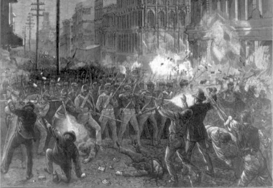 The cover of Harper's Weekly for Aug. 11, 1877, from a photograph by D. Bendann, depicts the 6th Maryland Regiment fighting its way through Baltimore en route to suppress the rail workers' strike. (Photo courtesy of Library of Congress) Photo: Library Of Congress / Library of Congress