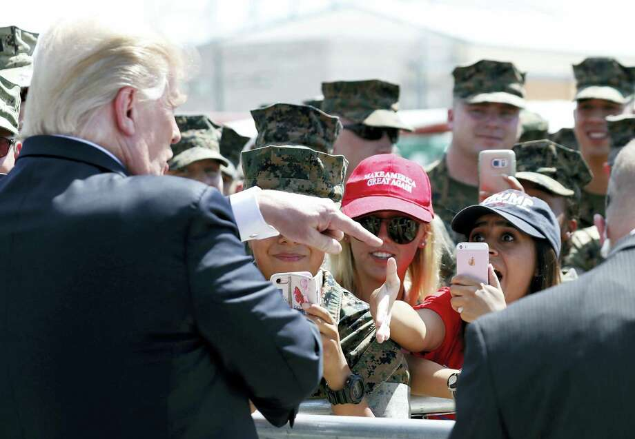 President Donald Trump greets U.S. Marines and their families before he departs Tuesday, Aug. 22, 2017, in Yuma, Ariz. Photo: Alex Brandon / AP Photo  / Copyright 2017 The Associated Press. All rights reserved.