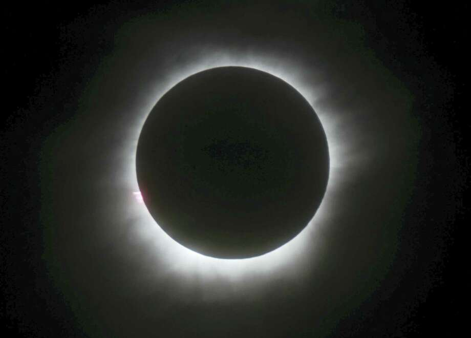 This March 9, 2016, file photo shows a total solar eclipse in Belitung, Indonesia. A solar eclipse on Monday, Aug. 21, 2017, is set to star in several special broadcasts on TV and online. PBS, ABC, NBC, NASA Television and the Science Channel are among the outlets planning extended coverage of the first solar eclipse visible across the United States in 99 years. (AP Photo/File) Photo: AP / Copyright 2017 The Associated Press. All rights reserved.
