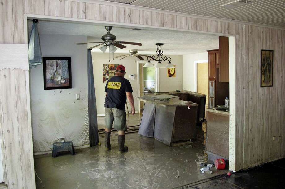 Dwight Chandler walks through his devastated home in Highlands, Texas on Thursday, Aug. 31, 2017. Chandler, 62, said he worried whether Harvey's floodwaters had also washed in pollution from the old acid pits that were designated as a U.S. EPA Superfund site just a couple blocks from his home. The Highlands Acid Pit site near Chandler's home was filled in the 1950s with toxic sludge and sulfuric acid from oil and gas operations. Photo: AP Photo/Jason Dearen   / AP